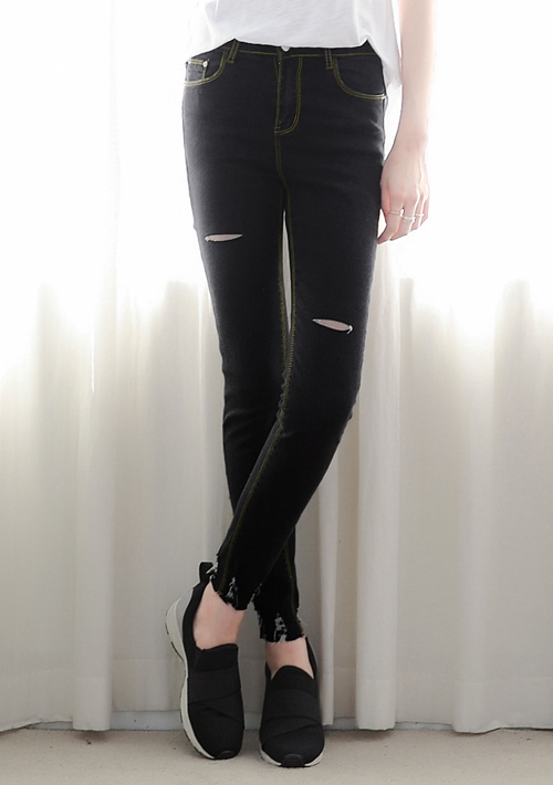 褲口抓破造型窄管牛仔褲